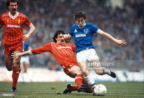 Sport Football Milk Cup Final at Wembley pic 26th March 1984 Everton 0 v Liverpool 0 aet Everton's Adrian Heath is tackled by Liverpool's Mark...