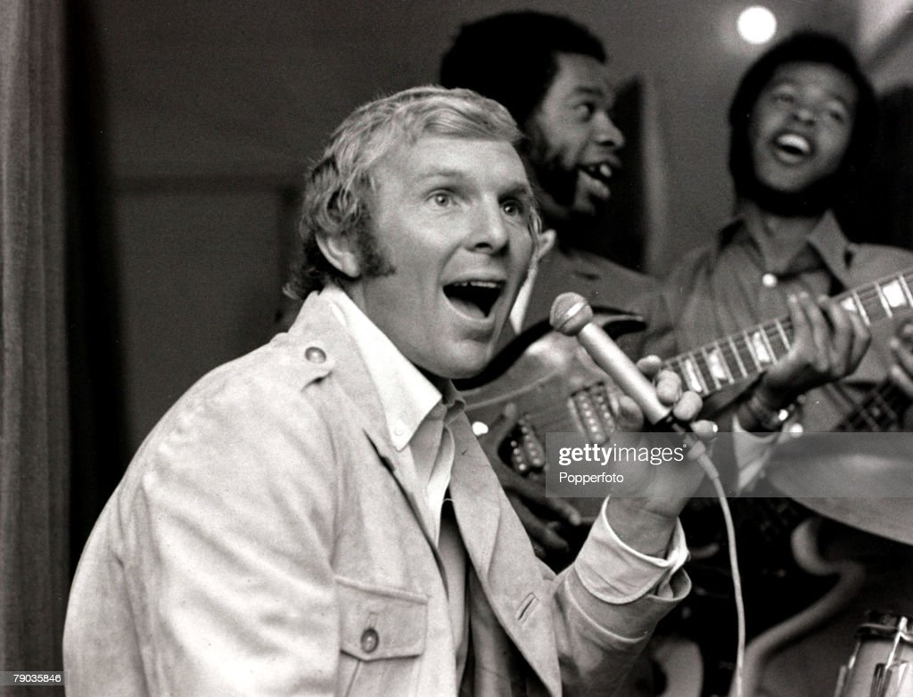 Sport, Football, Music, London, England, 28th August 1969, England and West Ham captain Bobby Moore is pictured in a recording studio with 'The Equals' pop group as he reworked their hit record 'Viva Bobby Joe' into 'Viva Bobby Moore'
