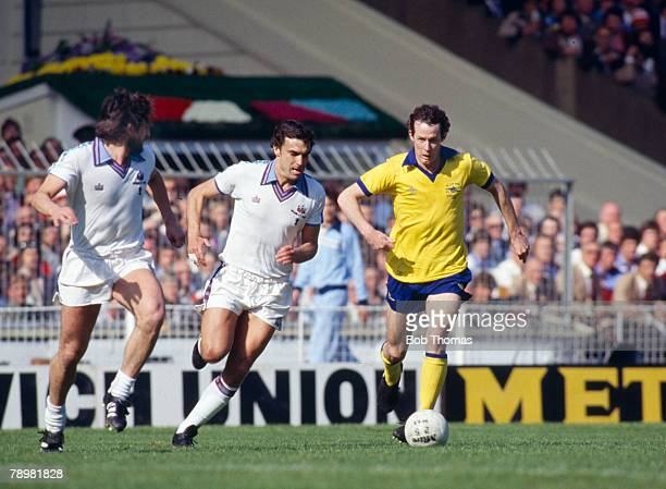 10th May 1980 FA Cup Final at Wembley West Ham United 1 v Arsenal 0 Arsenal's Liam Brady is challenged by West Ham pair Trevor Brooking centre and...