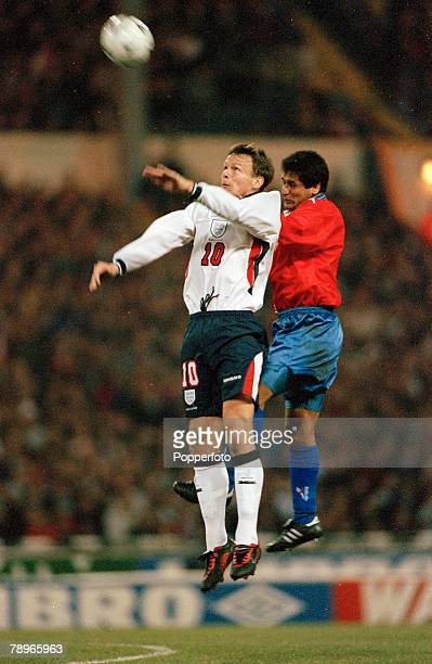 11th February 1998 Friendly International at Wembley England 0 v Chile 2 England's Teddy Sheringham leaps for a high ball with Chile's Ronald Fuentes...