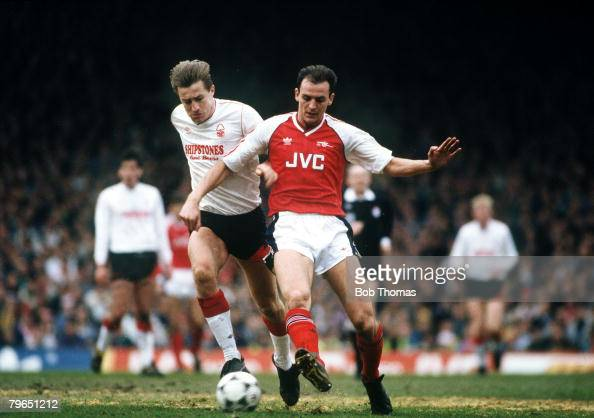 11th March 1989 Division 1 Arsenal 1 v Nottingham Forest 0 Arsenal's Steve Bould under pressure from Nottingham Forest striker Lee Chapman