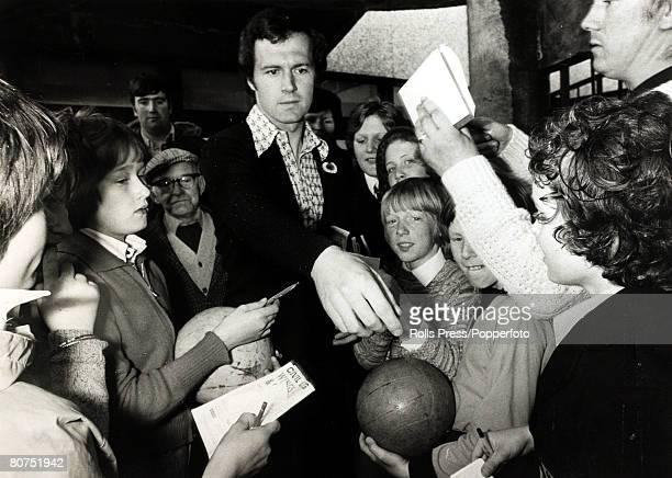 11th May 1976 Bayern Munich captain Franz Beckenbauer signs his autograph for an excited group of fans in Glasgow before his clubs European Cup Final...