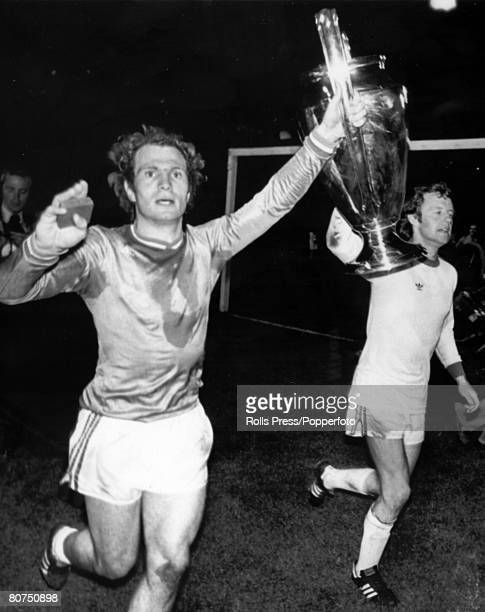 12th May 1976 European Cup Final at Hampden Park Glasgow Bayern Munich 1 v St Etienne 0 Bayern Munich's Uli Hoeness left and Jonny Hansen parade the...