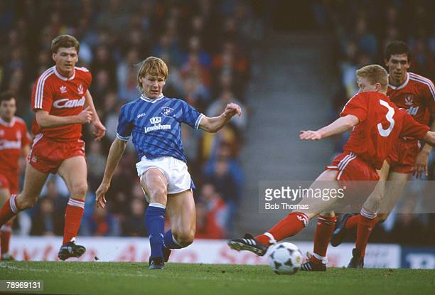 12th November 1988 Division 1 Liverpool 1 v Millwall 1 Millwall's Teddy Sheringham plays the ball past Liverpool's David Burrows Teddy Sheringham...
