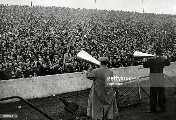 12th October 1935 Division 1 Chelsea v Arsenal at Stamford Bridge Stewards with megaphones marshalling the huge crowd on the terraces who have come...