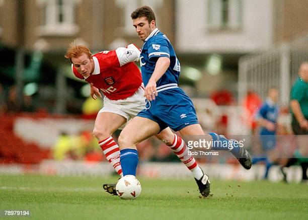 14th January 1994 Premiership Arsenal 1 v Everton 1 Everton's David Unsworth about to clear the ball as Arsenal's John Hartson challenges