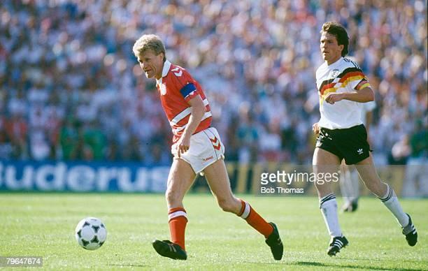 14th June 1988 European Championship Finals Gelsenkirchen West Germany 2 v Denmark 0 Denmark's Morten Olsen plays the ball as West Germany's Lothar...
