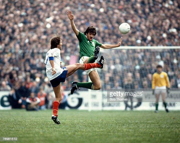 14th October 1981 World Cup Qualifier Republic of Ireland 3 v France 2 Republic of Ireland's Mark Lawrenson 'flies' in to challenge France's Rene...