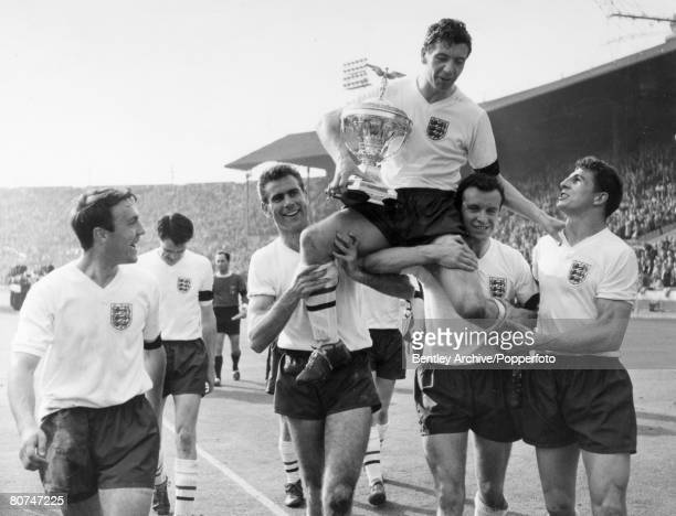 15th April 1961 British Championship at Wembley England 9 v Scotland 3 England captain Johnny Haynes is carried aloft on the shoulders of Peter Swan...