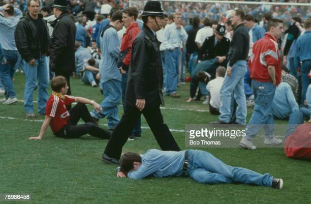 15th April 1989 FA Cup SemiFinal at Hillsborough Liverpool 0v Nottingham Forest 0 Match Abandoned Injured fans lying on the pitch at Hillsborough