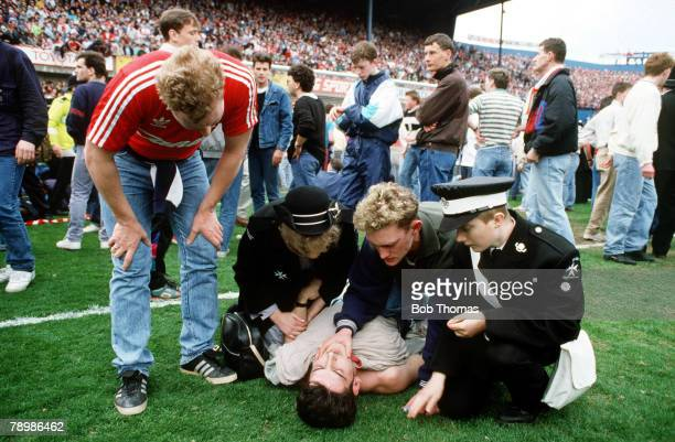 15th April 1989 FA Cup SemiFinal at Hillsborough Liverpool 0v Nottingham Forest 0 Match Abandoned A Liverpool fan receives medical attention