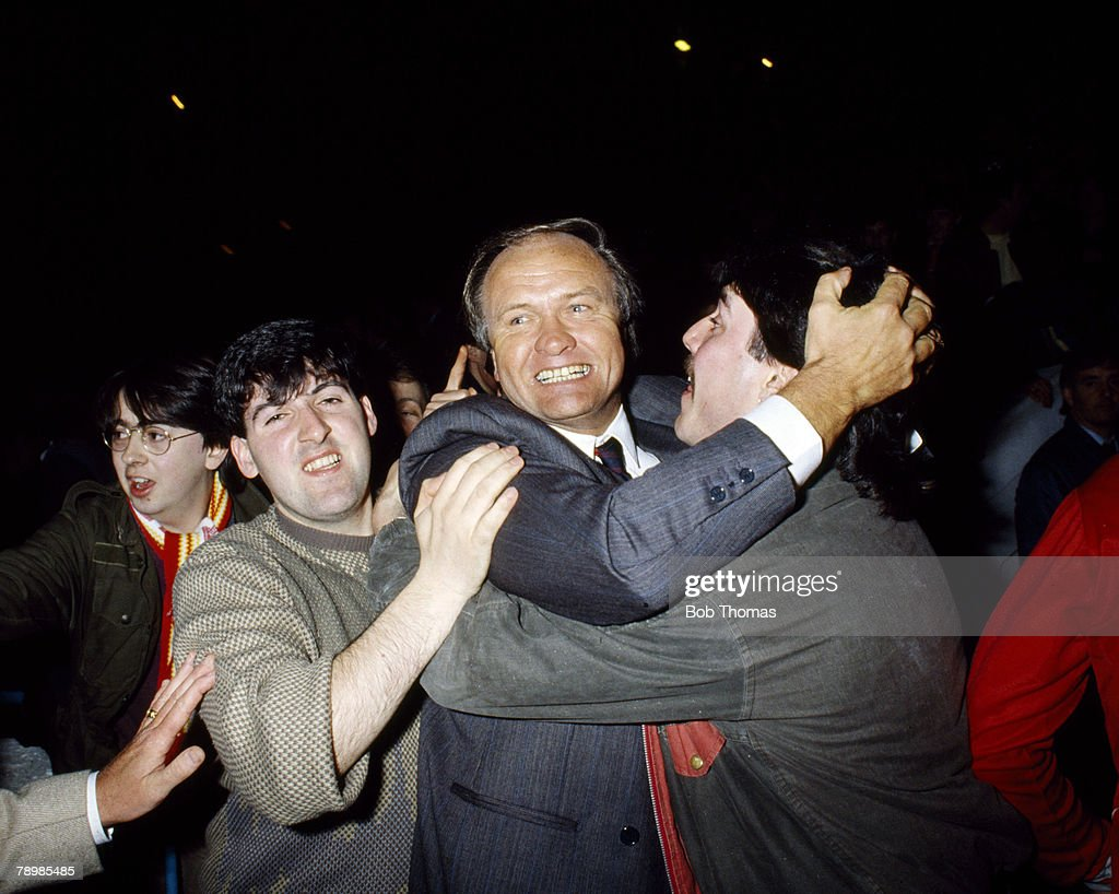 17th April 1985, FA Cup Semi-Final Replay at Maine Road, Manchester United 2 v Liverpool 1, Manchester United Manager Ron Atkinson mobbed by fans at the final whistle