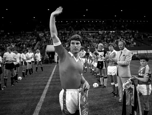 Sport. Football. pic: 17th August 1983. Martin Buchan Testimonial Match at Old Trafford. Martin Buchan waves to the crowd before the match. : News Photo