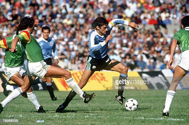 17th September 1989 World Cup Qualifier in Montevideo Uruguay 2 v Bolivia 0 Enzo Francescoli Uruguay takes on the Bolivian defence