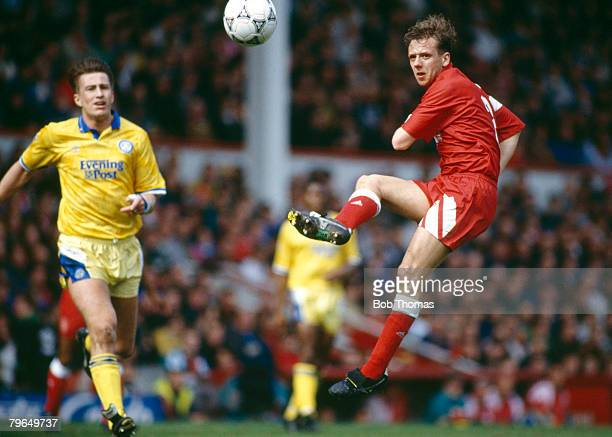 18th April 1992 Division 1 Liverpool 0 v Leeds United 0 Liverpool's Rob Jones clears the ball watched by Leeds United's Lee Chapman Rob Jones the...