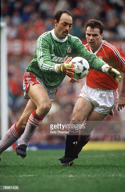 18th March 1990 Division 1 Manchester United 1 v Liverpool 2 Liverpool's Bruce Grobbelaar clears as Manchester United's Brian McClair challenges