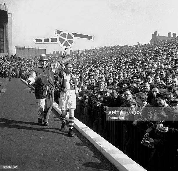 1953 Highbury Stadium London Arsenal supporters on the packed terrace as two cheerleaders parade in front