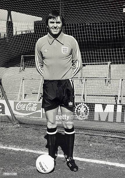 1976 Arsenal goalkeeper Jimmy Rimmer wearing his England kit in front of the North Bank at Highbury