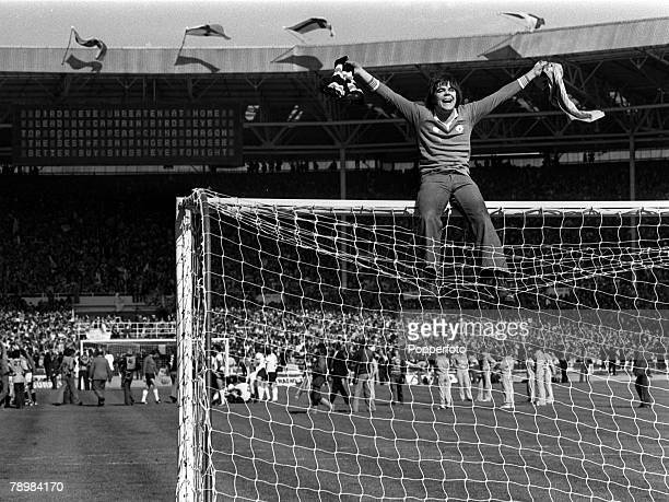 1977 1977 FA Cup Final at Wembley Manchester United 2 v Liverpool 1 An over enthusiastic Manchester United fan celebrates as he sits on top of the...