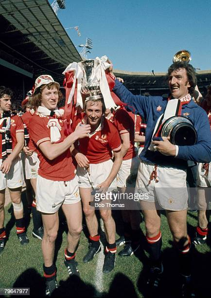 1977 FA Cup Final at Wembley Manchester United 2 v Liverpool 1 Manchester United's leftright Jimmy Nicholl Jimmy Greenhoff and Alex Stepney celebrate...