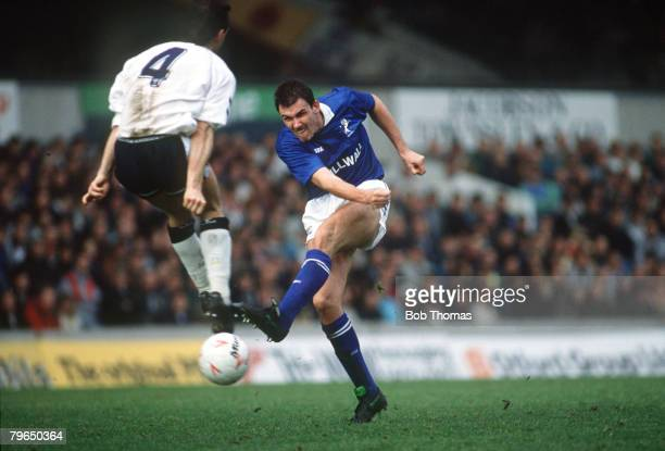 1989 Division 1 Tottenham Hotspurv Millwall Millwall's Tony Cascarino fires in a shot as Tottenham Hotspur's Paul Allen tries to block Tony Cascarino...