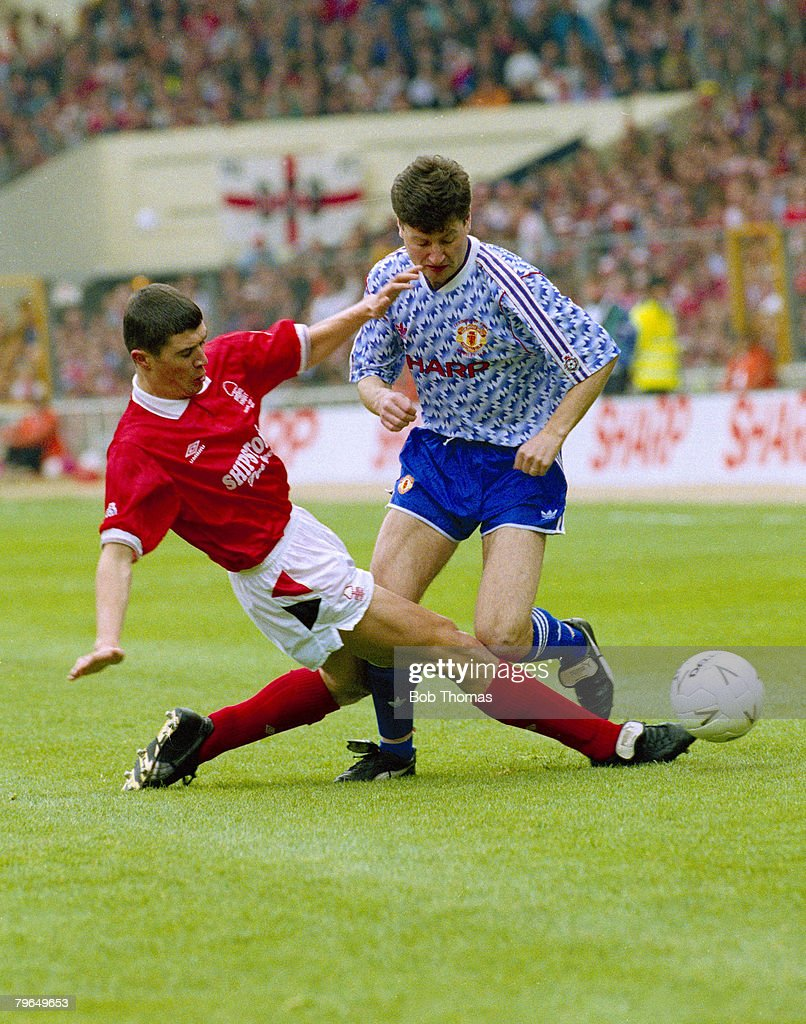 1992, Rumbelows League Cup Final at Wembley, Manchester United 1 v Nottingham Forest 0, Nottingham Forest's Roy Keane tackles Manchester United's Denis Irwin