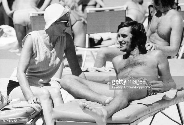 19th June 1972 Manchester United and Northern Ireland 'superstar' George Best pictured chatting to his landlady Mary Fullaway who herself was also...