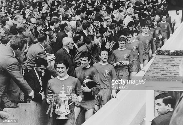 1st May 1965 FA Cup Final at Wembley Liverpool 2 v Leeds United 1 aet Liverpool captain Ron Yeats carries the trophy as the team follow as the...