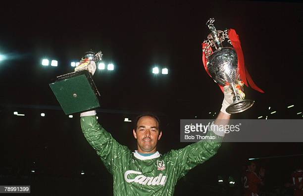 1st May 1990 Division 1 Liverpool 1 v Derby County 0Liverpool's Bruce Grobbelaar holds the League Champonship trophies aloft