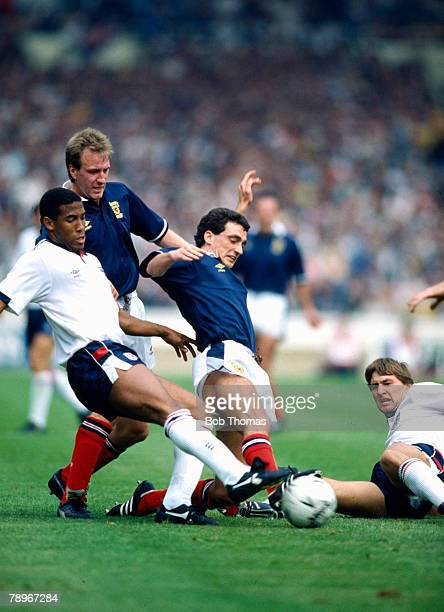 21st May 1988 Rous Cup at Wembley England 1 v Scotland 0 Scotland's Nil Simpson and Paul McStay contest the ball with England's John Barnes and Tony...