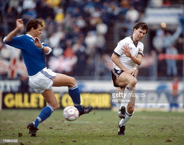 22nd May 1985 World Cup Qualifier in Helsinki Finland 1 v England 1 England captain Bryan Robson right and Finland's Pauno Kymalainen in battle for...