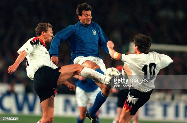 23rd March 1994 International Match in Stuttgart Germanyv Italy Italy's Pier Luigi Cairaghi is challenged by Germany's Guido Buchwald left and Lothar...