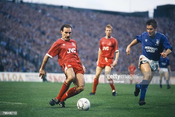 23rd October 1988 Scol Cup Final at Hampden Park Aberdeen 2 v Rangers 3 Aberdeen's Willie Miller plays the ball as Rangers' striker Ally McCoist...