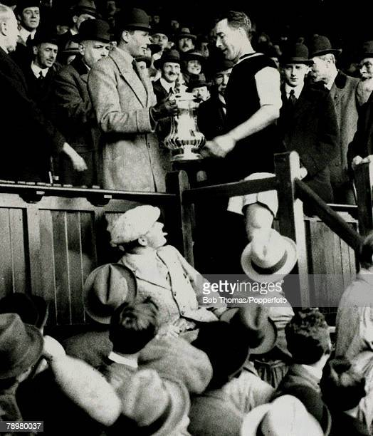 24th April 1920 1920 FA Cup Final at Stamford Bridge Aston Villa 1 v Huddersfield Town 0 after extra time Aston Villa captain Andrew Ducat receives...