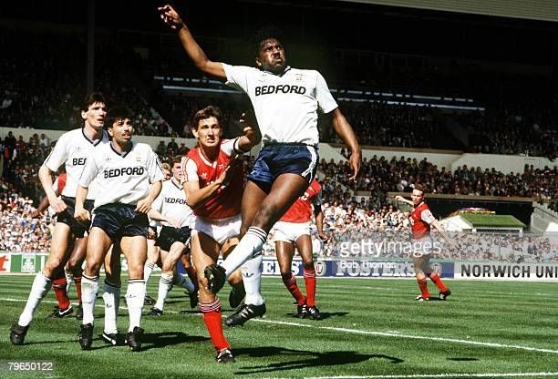 24th April 1988 Littlewoods Cup Final at Wembley Arsenal 2v Luton Town 3 Luton Town's Ricky Hill beats Arsenal's Tony Adams to clear with a header