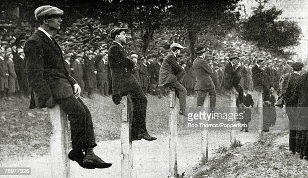 25th April 1914 FA Cup Final at Crystal Palace Burnley 1 v Liverpool 0 Spectators gain a vantage point by sitting on high wooden posts a splendid if...