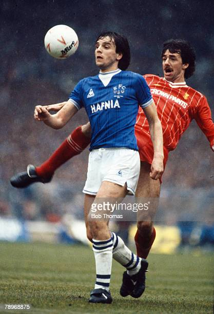 25th March 1984 Milk Cup Final at Wembley Graeme Sharp Everton striker 19791991 challenged by Liverpool defender Mark Lawrenson Graeme Sharp also won...