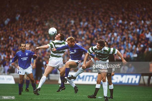 26th August 1989 Scottish Premier Division Celtic 1 v Rangers 1 Rangers striker Maurice Johnston is challenged by Celtic pair Mike Galloway and Roy...