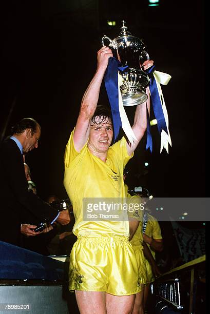 27th May 1982 FACup Final Replay at Wembley Queens Park Rangers 0 v Tottenham Hotspur 1 Tottenham Hotspur captain Steve Perryman proudly lifts the FA...