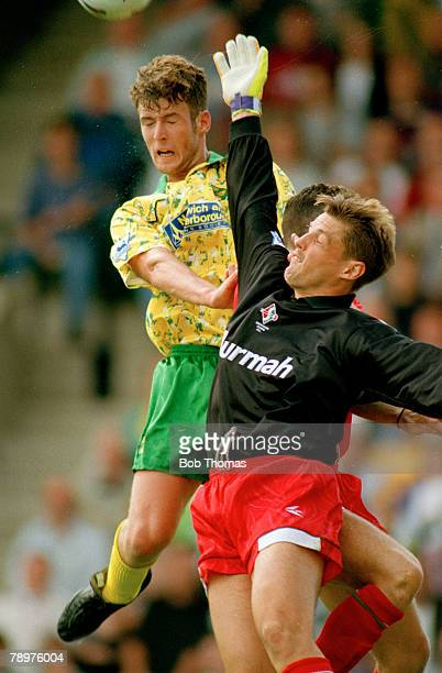 28th August 1993Premiership Norwich City 0 v Swindon Town 0 Norwich City's Chris Sutton jumps with Swindon Town goalkeeper Fraser Digby
