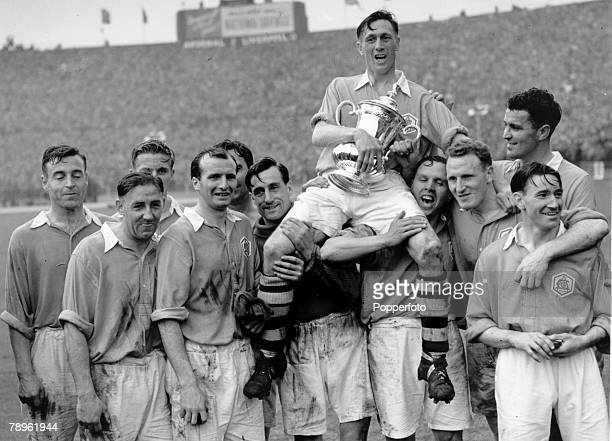 29th April 1950 FA Cup Final at Wembley Arsenal 2 v Liverpool 0 Arsenal captain Joe Mercer on the shoulders of goalkeeper George Swindin and Laurie...