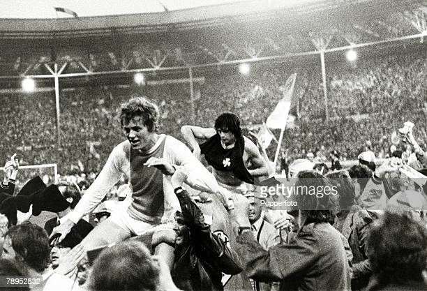 2nd June 1971 European Cup Final at Wembley Ajax Amsterdam 2 v Panathinaikos 0 Jubilant supporters carry Arie Haan left around Wembley at the end of...