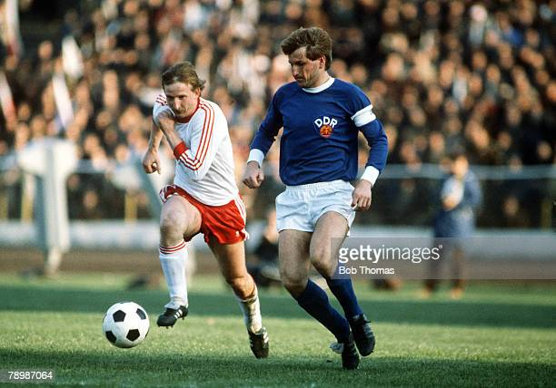 2nd May 1981 World Cup Quaifier Poland 1 v East Germany 0 East Germany's HansJurgen Dorner right is chased by Poland's Piotr Skrobowski