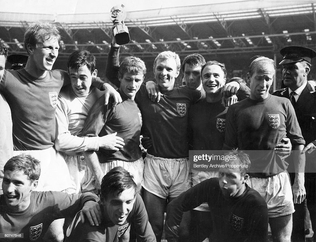 30th July 1966, 1966 World Cup Final at Wembley, England 4 v West Germany 2 aet, The England team (minus Nobby Stiles) with the trophy, Back row, left-right, Jack Charlton, <a gi-track='captionPersonalityLinkClicked' href=/galleries/search?phrase=Gordon+Banks&family=editorial&specificpeople=215465 ng-click='$event.stopPropagation()'>Gordon Banks</a>, <a gi-track='captionPersonalityLinkClicked' href=/galleries/search?phrase=Roger+Hunt&family=editorial&specificpeople=703571 ng-click='$event.stopPropagation()'>Roger Hunt</a>, <a gi-track='captionPersonalityLinkClicked' href=/galleries/search?phrase=Bobby+Moore&family=editorial&specificpeople=206646 ng-click='$event.stopPropagation()'>Bobby Moore</a>, Geoff Hurst, George Cohen, Bobby Charlton, Front row, left-right, <a gi-track='captionPersonalityLinkClicked' href=/galleries/search?phrase=Alan+Ball+-+World+Cup+Winner&family=editorial&specificpeople=213401 ng-click='$event.stopPropagation()'>Alan Ball</a>, <a gi-track='captionPersonalityLinkClicked' href=/galleries/search?phrase=Martin+Peters&family=editorial&specificpeople=643328 ng-click='$event.stopPropagation()'>Martin Peters</a>, Ray Wilson.