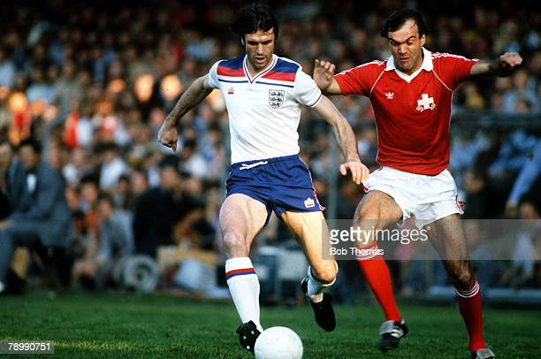 30th May 1981 World Cup Qualifier in Basle Switzerland 2 v England 1 England defender Dave Watson is chased by Switzerland's Elsener
