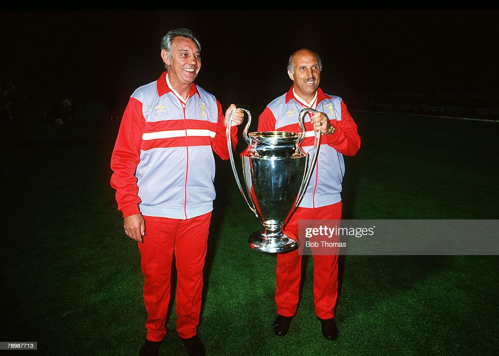 30th May 1984, European Cup Final in Rome, Liverpool beat Roma 4-2 on penalties after 1-1 draw a,e,t, Joe Fagan, the Liverpool Manager holds the trophy with his assistant Ronnie Moran (1934-2017), right
