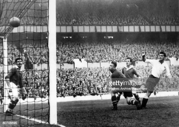 31st August 1950 Division 1 Tottenham Hotspur v Bolton Wanderers Tottenham Hotspur striker Len Duquemin right beats the Bolton defence to score...