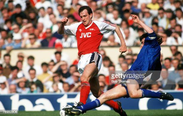 31st March 1990 Division 1 Arsenal 1 v Everton 0 Arsenal's Martin Hayes is tackled by Everton's Ian Snodin