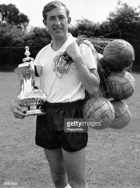 3rd August 1962 Tottenham Hotspur captain Danny Blanchflower at the preseason photocall carrying a net of footballs and the FA Cup