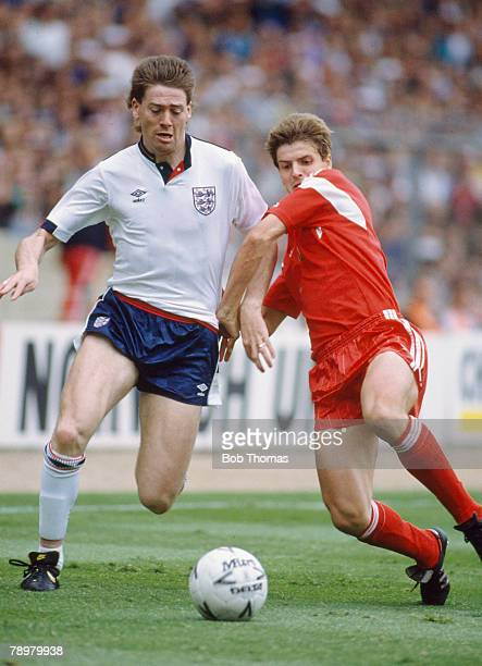 3rd June 1989 World Cup Qualifier at Wembley England 3 v Poland 0 England's Chris Waddle and Poland's Dariusz Wdowczyk in a race for the ball Chris...